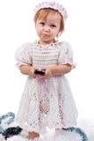 Bebé hermoso con un teléfono móvil Fotos de archivo libres de regalías