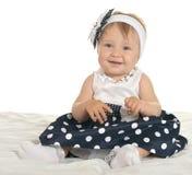 Bebé hermoso en vestido lindo Imagenes de archivo