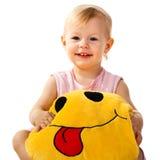 Bebé hermoso que sostiene una almohadilla Fotografía de archivo libre de regalías