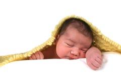 Bebé infantil en la parte posterior del blanco Foto de archivo libre de regalías