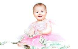 Bebé infantil que joga com dinheiro Fotografia de Stock Royalty Free