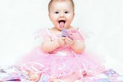 Bebé infantil que joga com dinheiro Imagens de Stock Royalty Free