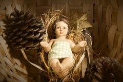 Bebé Jesús en la tarjeta de Navidad del pesebre Foto de archivo libre de regalías