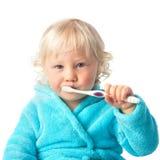 Bebé lindo con el cepillo de dientes Imagenes de archivo