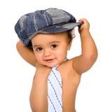 Bebé lindo con el lazo y el casquillo Imagen de archivo