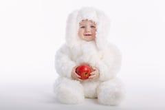 Bebé lindo con el traje del conejo Foto de archivo