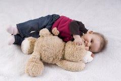 Bebé lindo con la muñeca Imagen de archivo libre de regalías