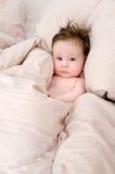 Bebé lindo en cama imágenes de archivo libres de regalías