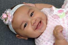 Bebé lindo en color de rosa Imagenes de archivo