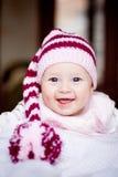 Bebé lindo en un sombrero con el pompom Imagen de archivo libre de regalías