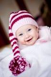 Bebé lindo en un sombrero con el pompom Fotos de archivo libres de regalías