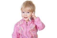 Bebé lindo que habla en el teléfono móvil Fotos de archivo libres de regalías