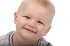 Bebé lindo que mira en la cámara Foto de archivo libre de regalías