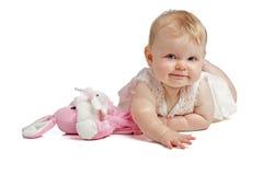Bebé lindo que sonríe en sundress sin mangas Foto de archivo