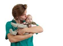 Bebé masculino del examen del doctor Fotografía de archivo libre de regalías