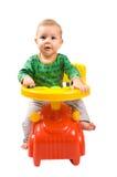 Bebé-muchacho en un coche Foto de archivo libre de regalías