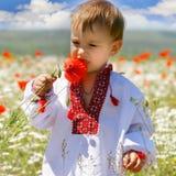 Bebé na roupa tradicional Fotos de Stock Royalty Free