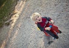 Bebé no campo de jogos Foto de Stock Royalty Free