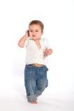 Bebé ocasional con el teléfono Fotografía de archivo