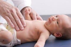 Bebé Palpating Foto de archivo libre de regalías