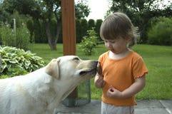Bebé, perro y helado Foto de archivo libre de regalías