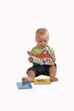 Bebé que cuenta historia Fotos de archivo