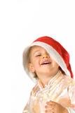 Bebé que desgasta el sombrero de Papá Noel imagenes de archivo