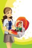 Bebé que lleva de la madre Fotografía de archivo