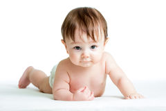 Bebé que miente en la panza Imágenes de archivo libres de regalías