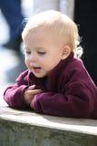 Bebé que mira abajo Imagen de archivo libre de regalías