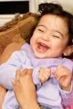 Bebé que ríe nerviosamente Imagen de archivo libre de regalías