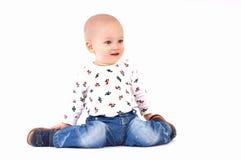 Bebé que se sienta en su regazo Fotos de archivo