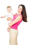 Bebé que se sienta en sus manos de la madre imágenes de archivo libres de regalías