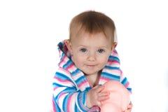 Bebé que sonríe con el juguete Fotografía de archivo
