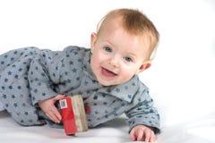 Bebé que sonríe con el libro Imagen de archivo libre de regalías