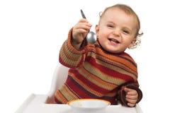 Bebé que tiene comida Imágenes de archivo libres de regalías