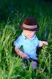 Bebé que toma el sol Fotografía de archivo