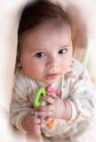 Bebé recién nacido con el juguete Fotografía de archivo libre de regalías