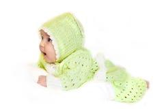 Bebé recién nacido en guardapolvos Imagen de archivo libre de regalías