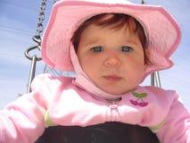 Bebé rosado en un oscilación imágenes de archivo libres de regalías