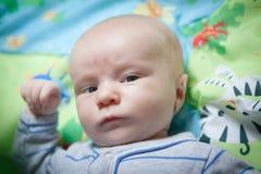 Bebé seriamente lindo Fotografía de archivo