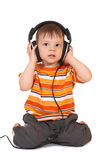 Bebé sonriente con los auriculares Imágenes de archivo libres de regalías