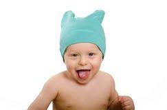 Bebé sonriente en casquillo Foto de archivo