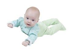 Bebé sonriente en el fondo blanco Fotos de archivo libres de regalías