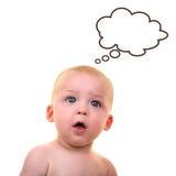 Bebé sorprendido con la burbuja del pensamiento Imágenes de archivo libres de regalías