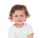 Bebé triste que mira la cámara Foto de archivo libre de regalías