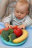 Bebé y alimento sano Foto de archivo libre de regalías