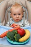 Bebé y alimento sano Imagen de archivo libre de regalías