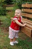 Bebé y banco Fotos de archivo libres de regalías