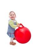 Bebé y bola roja Fotos de archivo